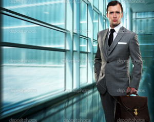 Businessman inside modern building - Stock Image