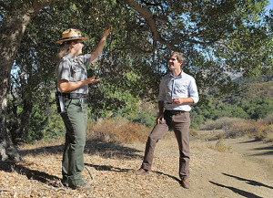 David Szymanski shares some shade with park guide Bethany McCormick.