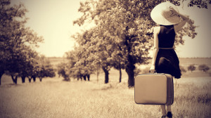 young-woman-with-suitcase-in-a-country.jpg