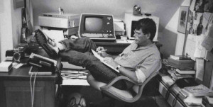 Stephen King working at home with his dog