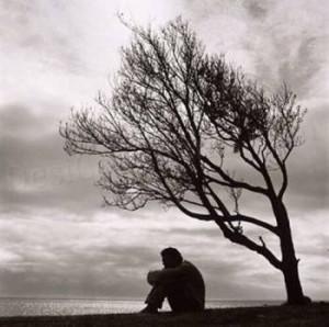 boy sitting on sea shore alone in love