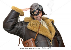 Funny fighter pilot saluting isolated in white