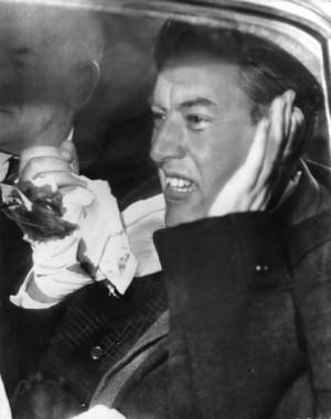 Ian Paisley nurses a cut hand as he leaves his Belfast home for