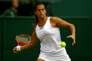 Amelie Mauresmo plays a forehand in her match against Dinara Safina