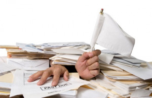Man Buried in Paperwork - Photo courtesy of ©iStockphoto.com ...