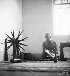 Margaret Bourke-White: Indian leader Mohandas Gandhi reading as he ...