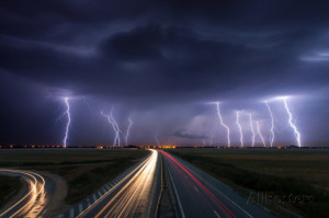 Thunderstorm and Lightnings in Night over A Highway with Car Lightning ...