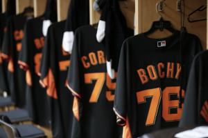 San Francisco Giants uniforms line the locker room during spring ...