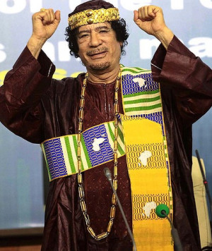 Always outspoken ... Muammar Gaddafi gestures as he attends the Second ...