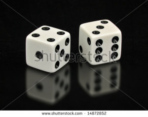 Two White Dice With The Lucky Number Seven Showing Are