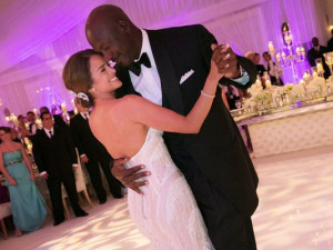 Michael Jordan dances with his bride Yvette Prieto during their ...