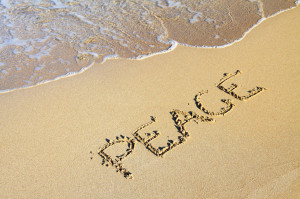 Word Peace In Sand by Petr Kratochvil