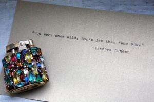 Isadora Duncan quote typed on vintage typewriter on metallic paper