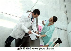 Medical secretary showing record to doctor
