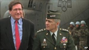 Richard Holbrooke (left) is escorted by US Gen Wesley Clark after ...