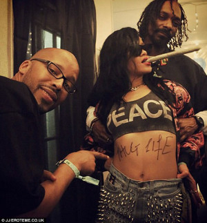 ... Snoop Dogg and Warren G as she shows off a 'tribute' to Tupac Shakur