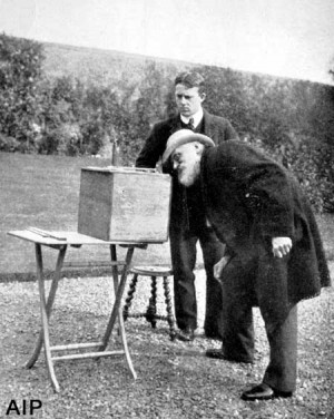 Lord Kelvin and his assistant conducting an experiment with an azimuth ...