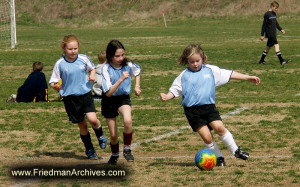 Kids and Sports /Girls Playing Soccer