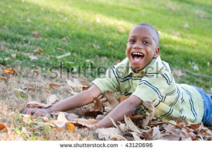 stock-photo-young-african-american-boy-having-fun-in-the-park-43120696 ...