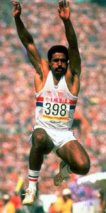 DALEY THOMPSON executing his long jump en route to successfully ...