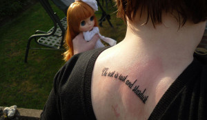 Adoption Quotes Tattoos This back tattoo bears a quote