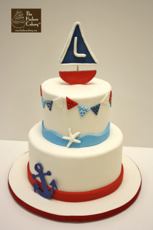 Monogrammed sailboat cake for a boy's birthday party