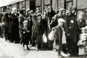 Jews wearing the star emblem, arrive in Auschwitz, in German-occupied ...