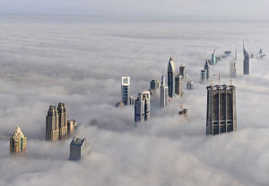 Funny photos Dubay buildings above clouds
