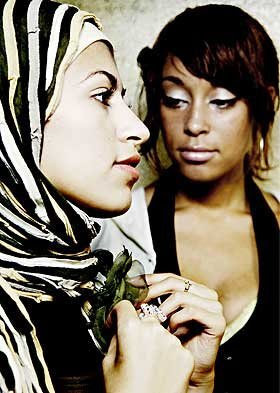... , and a headscarf) is that it isn't supposed to make us stand out