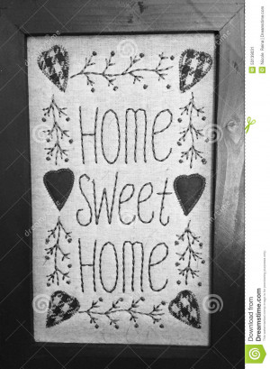 ... and white photo displaying quote Home Sweet Home with hearts and