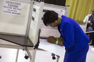 candidate Muriel Bowser, right, fills out her ballot on election day ...