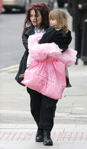 Helena Bonham Carter carries her tutu-clad daughter Nell after the ...