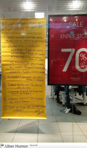 Employees leave a protest sign at failing Wet Seal mall store
