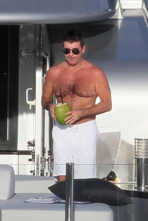 simon cowell plays with fruit in this photo simon cowell simon cowell ...