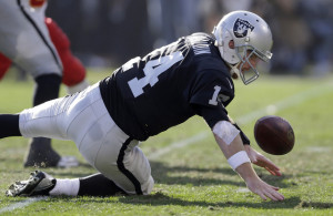Oakland Raiders quarterback Matt McGloin (14) fumbles against the ...
