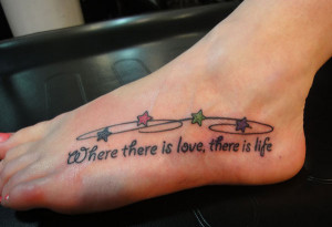 Quote Tattoo with colourful stars on the Foot