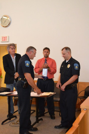 Hillsboro Police Chief Todd Whited, left, presents an award to Officer ...