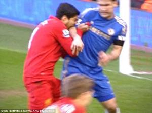 The tooth hurts: Luis Suarez bites the arm of Branislav Ivanovic and ...