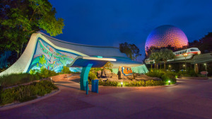 The Seas with Nemo & Friends Pavilion lit up at night, next to a ...