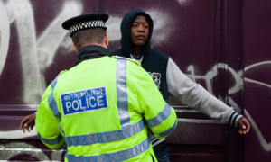 young black man is searched by a Metropolitan police officer in ...