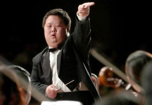 Down Syndrome boy Zhou Zhou is also a famous talented conductor.