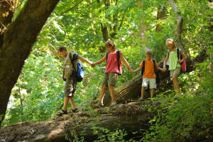 Kids hiking in forest. Credit: American Forests.