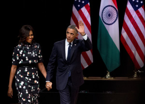 Obama with his wife Michelle Obama at the Siri Fort auditorium (AP ...