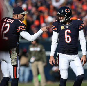 Bears quarterbacks Josh McCown (12) and Jay Cutler (6) talk in the ...