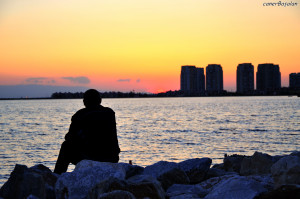 lonely guy watching sundown by svennG