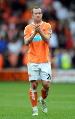 Charlie Adam Charlie Adam of Blackpool applauds the supporters at full