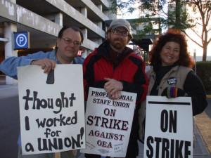 OEA employees on strike, summer 2010. Written on the middle striker's ...