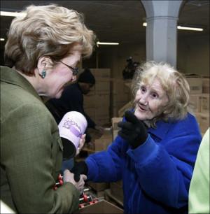 Rep Marcy Kaptur left listens to Marjorie Orwig a Toledo