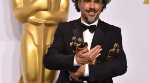 Alejandro Gonzalez Inarritu poses in the press room with his awards ...