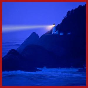 Lighthouse beams across stormy night sea
